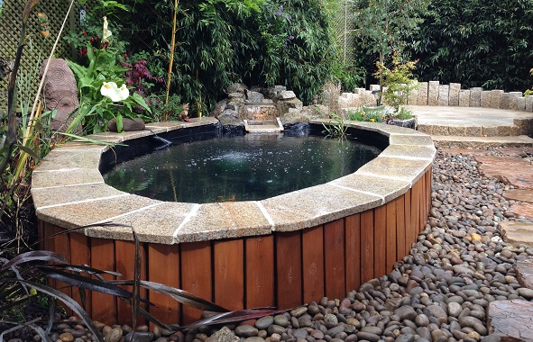 Rockworld water features installation for Raised pond design ideas